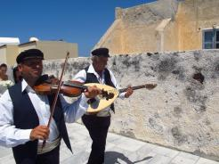 Part of a wedding procession in Oia, Santorini