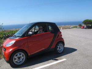 Sarah in her smart car on Santorini