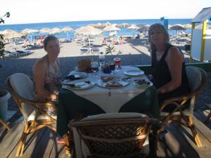 Eating again!! This time at the black beach, Santorini