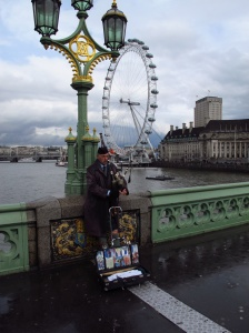 Bagpipe busker near Westminster, London