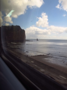 The train runs along the coast on the way to Exeter