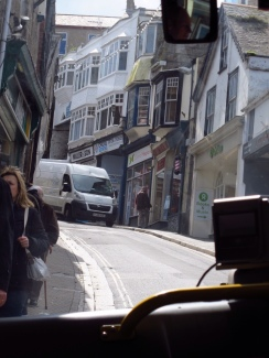 Watch out, bus coming through. Driving on the footpath in St. Ives, England