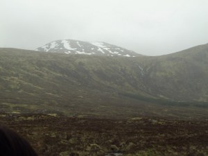 Snow on the mountains in summer, Scottish highlands