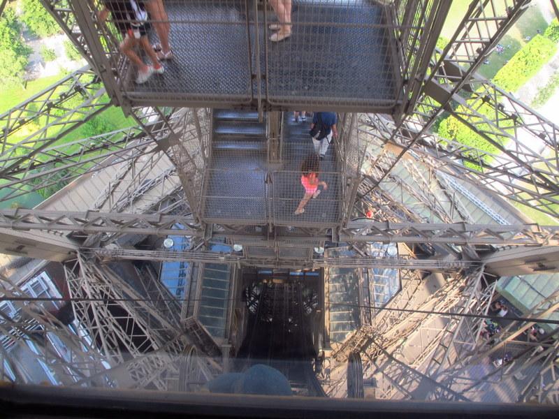 Energetic people walking down the tower stairs