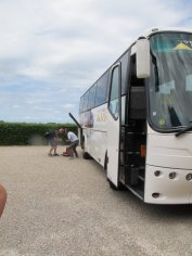 Fixing the bus on our winery tour from Bordeaux