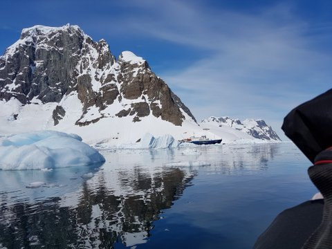 Plancius appearing from behind an iceberg at Lemaire Channel